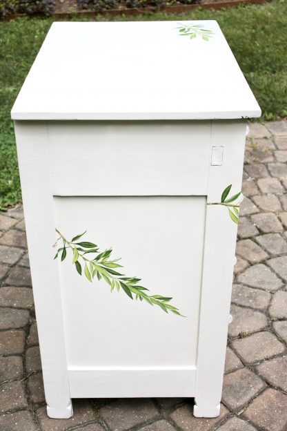 upcycled white dresser with flowers
