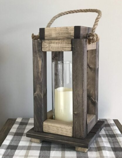 wood and rope lantern with glass hurricane