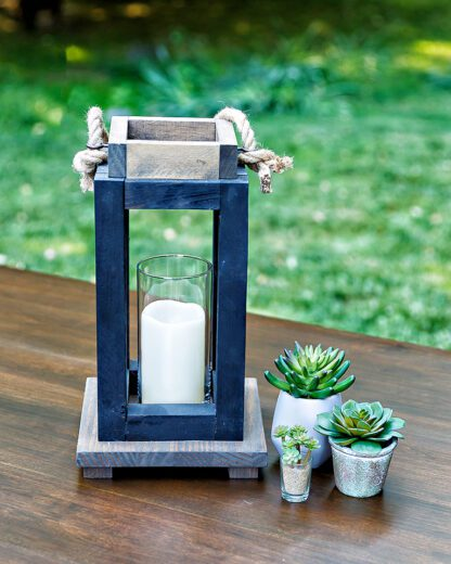 Wooden lantern with glass hurricane