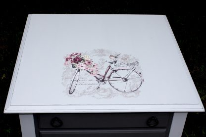 2 drawer light and dark gray end table with bicycle accent